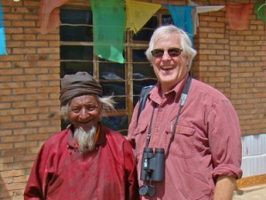 A smiling Smith with a Tibetan pastoralist