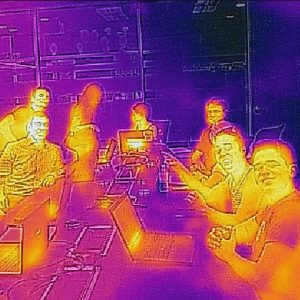 Students with laptops smiling in infrared