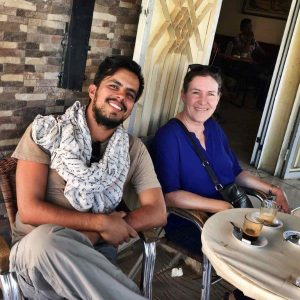 Two scientists enjoying coffee outside a Moroccan cafe