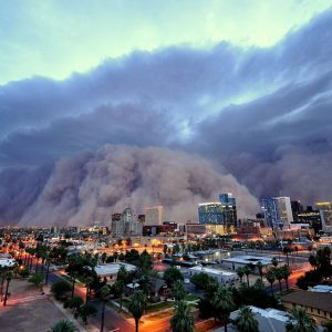 A massive wall of dust rolls over Phoenix at dusk