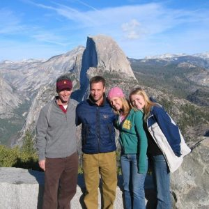 Researcher Dave White and students smiling at Yosemite National Park
