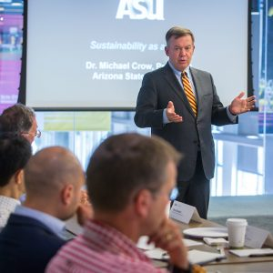 "ASU President Michael Crow addresses the kick-off luncheon for founding members meeting of the Global Consortium for Sustainability Outcomes, on the Tempe campus, on Tuesday, Oct. 25, 2016. Nearly two dozen people representing the 12 founding members, from eight countries, listened to Dr. Crow ask the rhetorical question, ""Could sustainability ever be a value?"""