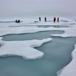 Researchers walk on melting ice