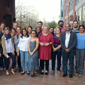 Sustainability researchers gather on brick walkway for group photo