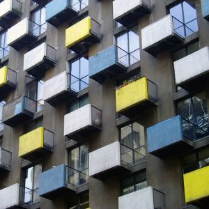 Colorful balconies of a high-rise apartment complex