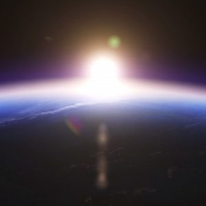 Satellite view of sun rising behind Earth