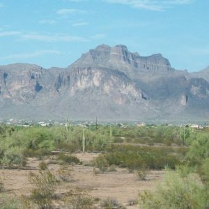 View of desert community at the foot of large rocky mountains