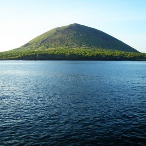 Small Galapagos island hill surrounded by sea water