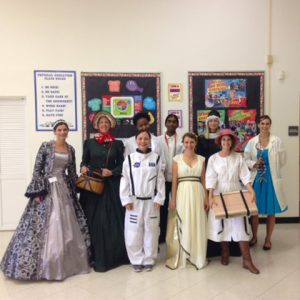 Group of volunteers dressed up as historical science characters