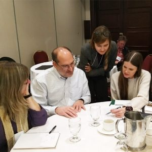 Working group discusses paper around table