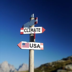 Road signs with Climate and USA pointing different directions