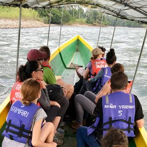Group of professors ride boat across river