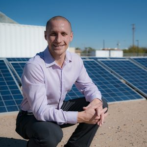 DR. Nathan Johnson in front of Solar Panels
