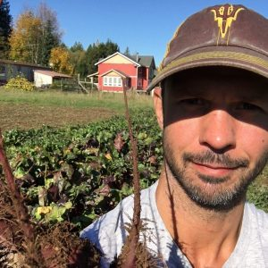 ASU student Adam Gabriele poses on a farm
