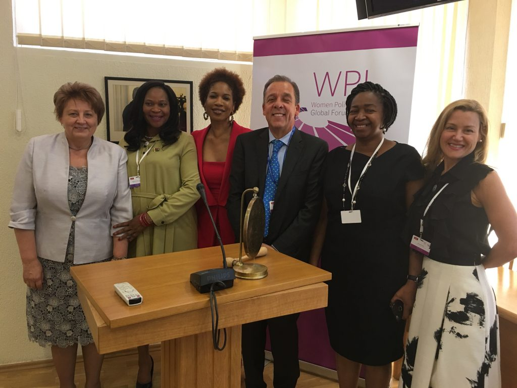 Amanda Ellis, right, stands with five leaders at the Women Political Leaders Summit 2018