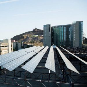 Solar panels line the top of a building on ASU campus in Tempe