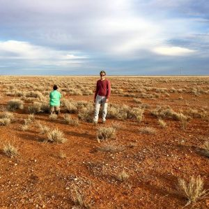 ASU student stands in the middle of Australian desert