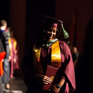 ASU student walks across the stage at School of Sustainability convocation