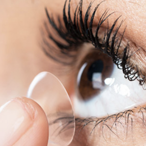 contact lens being applied to eye
