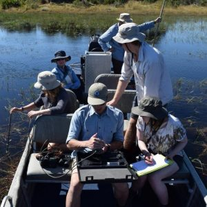 ASU students in Botswana analyzing wetlands water for oxygen levels and microorganisms