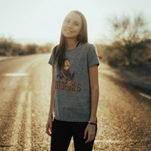 Woman standing on road wearing ASU shirt