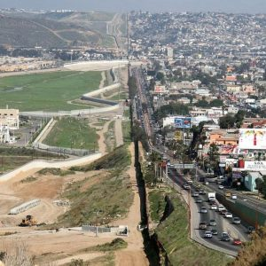 A small fence separates the densely populated Tijuana, Mexico (right) from the United States in the Border Patrol's San Diego sector