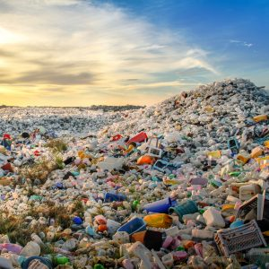 Huge expanse of plastic waste with sunset