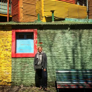 René Edde stands in front of brightly colored walls