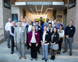 About 20 people from Glendale and ASU pose in front of Wrigley Hall