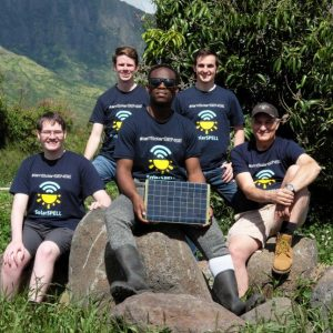 SolarSPELL students posing with solar panel
