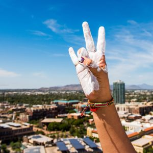ASU forks up A mountain hand with white paint
