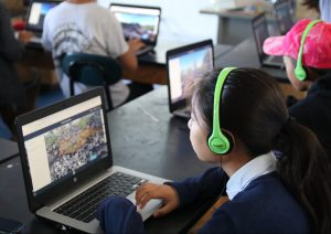 Young students in a classroom taking a virtual class