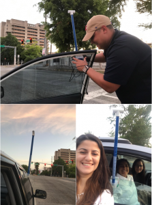 Citizen science volunteers putting temperature sensors on windshields of cars