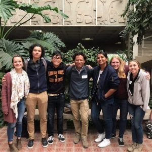 Group of 7 sustainability students standing together for photo in atrium