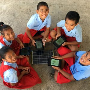 children using SolarSPELL technology for learning