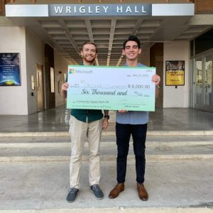 Arizona State University students standing with $6,000 check