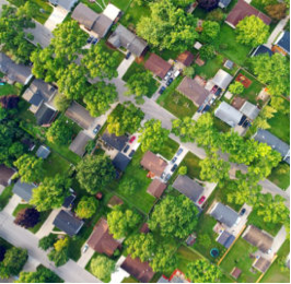 view of neighborhood from above, with lots of trees