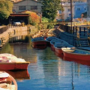 Japanese canal with red boats